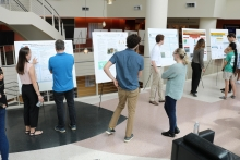 Students attending the Aquatic Chemical Ecology REU prepare for poster session presentations July 20. (Photo Renay San Miguel)