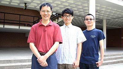 (Left to right) Xingxing Yu, with graduate students Yan Wang and Dawei He.